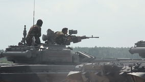 Soldiers shoots from tank-mounted machine guns stock footage