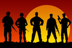 Soldiers. Silhouettes of soldiers at sunset Stock Photography