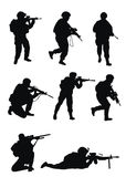 Soldiers silhouettes. On white background Royalty Free Stock Photos