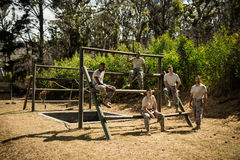 Soldiers sitting on the obstacle course in bootcamp Royalty Free Stock Image