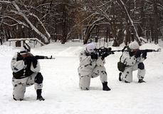 The soldiers of the special detachment are working out combat coordination in the neutralization of terrorists in winter condition. MOSCOW, RUSSIA - JANUARY 20 Stock Photo