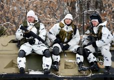 Soldiers special unit on the armored personnel carrier. MOSCOW, RUSSIA - JANUARY 20, 2016: Soldiers special unit on the armored personnel carrier royalty free stock photo