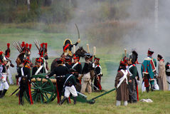 Soldiers stand by a cannon. Royalty Free Stock Photos