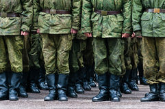 Soldiers stand in formation legs only Royalty Free Stock Photography