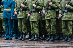 Soldiers stand in formation with officer Stock Photography