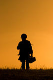 Soldiers standing against sunset Stock Image