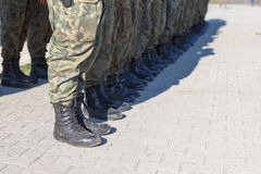 Soldiers standing in a row. Outdoors stock photo
