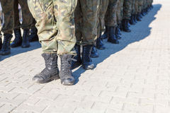 Soldiers standing in row. Outdoors royalty free stock photos