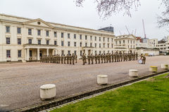 Soldiers standing to attention and being inspected outside Well Stock Images