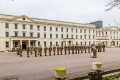 Soldiers standing to attention and being inspected outside Well Royalty Free Stock Images