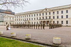 Soldiers standing to attention and being inspected outside Well Royalty Free Stock Photos