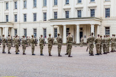 Soldiers standing to attention and being inspected outside Well Royalty Free Stock Photography