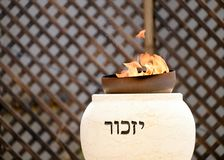 Memorial flame burning at memorial ceremony on Memorial Day. TZUR SHALOM CEMETERY, ISRAEL - MAY 1, 2017. Memorial flame burning at memorial ceremony on Memorial stock image