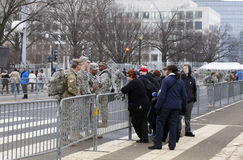 Soldiers talk to civilians during Inauguration of Donald Trump. WASHINGTON, DC - JANUARY 20: American soldiers assist civilians during inauguration of Donald Royalty Free Stock Photo