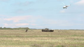 Soldiers and tank attacking on battlefield. Soldiers and tank attacking on training battlefield stock footage