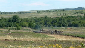 Soldiers and tank attacking on battlefield. Soldiers and tank attacking on training battlefield stock video