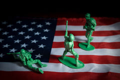 Soldiers toys on USA flag Stock Photos