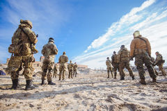 Soldiers in training. Men in military uniform while training outdoors stock photos
