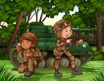 Soldiers. Two soldiers with armed by the tank Stock Images