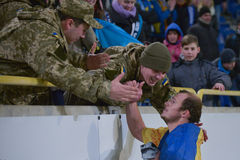 Soldiers of Ukrainian army and football player Royalty Free Stock Photo