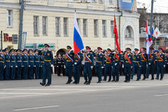 Soldiers in uniform with flags are at rehearsal of Military Parade Royalty Free Stock Image