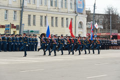 Soldiers in uniform with flags are at rehearsal of Military Parade Stock Images