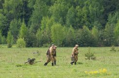 Soldiers walk with Maxim machine gun Royalty Free Stock Photography