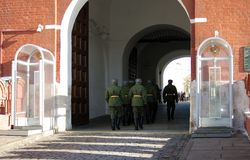 Soldiers walk in Moscow Kremlin. UNESCO World Heritage Site. Royalty Free Stock Image