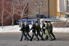 Soldiers walk in Moscow Kremlin. UNESCO World Heritage Site. Stock Photo