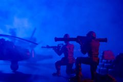 Soldiers into the war. Showing in blue lighting and with smoke royalty free stock photo