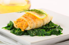 Sole. Delicious sole stuffed with crab on spinach Royalty Free Stock Images