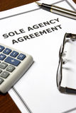 Sole Agency Agreement. Image of a sole agency agreement on an office table Stock Photography