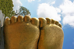 Sole of Buddha feet. With the bue sky as background Royalty Free Stock Photo