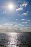 Sole di pomeriggio sopra il mare Immagine Stock Libera da Diritti