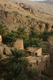 Sole di sera sopra bello Misfat Al Abreyeen, Oman immagini stock libere da diritti