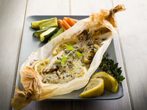 Sole fish cocked in a wrapper. With herbs and sliced lemon Royalty Free Stock Photos