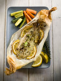 Sole fish cocked in a wrapper. With herbs and sliced lemon Stock Photos