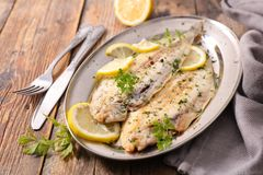 Sole fish cooked with herb stock photo