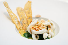 Sole fish soup. With baby spinach and fried almonds. Fancy 1 star Michelin dinner Stock Images