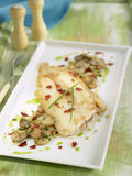 Sole with mushrooms,dried tomatoes, garlic, chives Royalty Free Stock Photography