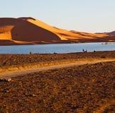 sole nel deserto di giallo del lago della sabbia e della duna del Marocco Fotografia Stock