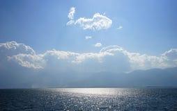 Sole nel mare Immagine Stock