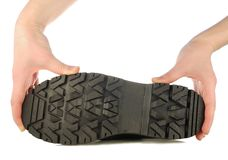 Sole of rough boot in a hands. Rough boot on a high thick sole Royalty Free Stock Photography