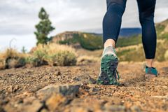 Sole of shoe walking in mountains on rocky footpath Stock Images