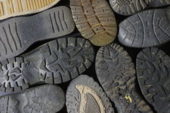 Soled shoes objects group Royalty Free Stock Photos