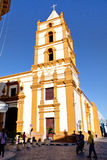 The Soledad church in Camaguey. Some People walk on the street in front of the church Royalty Free Stock Photo