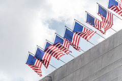 Solemn flags of the USA. Picturesque streets of Los Angeles. Patriotic national flags of the USA on the facades of public buildings Royalty Free Stock Images