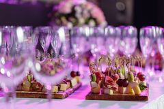 Solemn happy new year banquet. Lot of glasses champagne or wine on the table in restaurant. buffet table with lots of. Delicious snacks. canapes, bruschetta royalty free stock photos