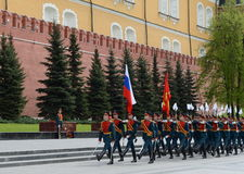 Solemn March of the honor guard after laying flowers to the tomb of the Unknown Soldier in Moscow. MOSCOW, RUSSIA - MAY 8, 2014: Solemn March of the honor guard Stock Images