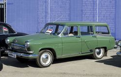 Solemn opening of the salon for the sale of automobiles, Firm `Nizhegorodets.` Green Volga GAZ 21 estate. royalty free stock photo